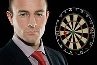 Businessman and dartboard
