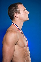 Muscular athlete with a medal