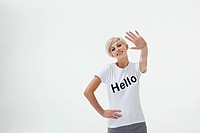 Young woman wearing t_shirt that says hello