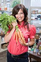 Woman in store with carrots
