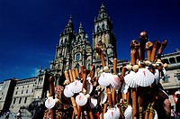 Plaza Obradoiro with western facade of Santiago Cathedral. Stall selling symbols of camino scallop shells and staffs