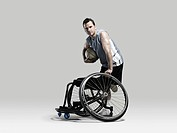 Basketball player with ball and wheelchair