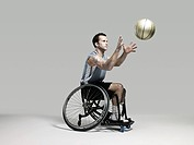 Wheelchair basketball player catching ball