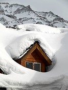 Snow covered dormer window in a chalet