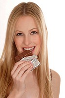long_haired blonde woman eating chocolate.