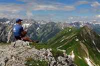 Mountaineer looking at the mountain panorama, Pfafflar, Lechtal Valley, Reutte, Tyrol, Austria, Europe