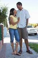 Couple walking down pavement