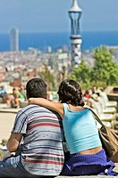 A young couple admires the view at Park Guell