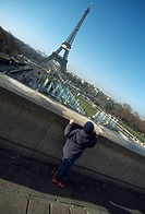 Boy looking at Eiffel Tower