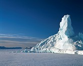 Iceberg on frozen sea