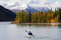 Kayaker on Kathleen Lake in Indian summer, St. Elias Mountains behind, Kluane National Park, Yukon, Canada, North Canada