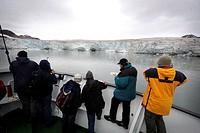 A boat trip to ice glacier in Spitsbergen, Svalbard. Longyearbyen, Norway.