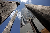 Low angle view of sculptures and skyscrapers