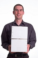 Man smiling as he carries two parcel boxes