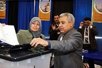 Southgate, Michigan - Iraqis living in the United States vote in Iraq's national election  An election official opens the lid to the ballot box as Zah...