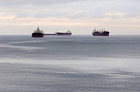 Large cargo vessels anchored in English Bay waiting to dock at the port of Vancouver, Vancouver, British Columbia, Canada, North America