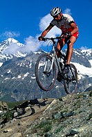 Mountainbiker in front of Mt. Obergabelhorn, Zermatt, Wallis, Switzerland, Europe