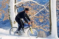 chimney sweeper on a mountainbike in winter