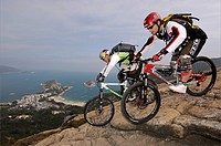 Mountain bikers on Hong Kong Island, Shek_O_Bay, Hong Kong, China, Asia