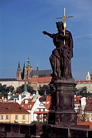 Charles Bridge, Prague, Czech. Baroque statue on Charles Bridge with Hradcany St  Vitus Cathedral in background. Charles Bridge (Prazsk&#253; most) is a fa...