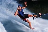 man water skiing barefoot