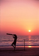 Patnem Beach, Goa, India  Local cricket player on beach at sunset