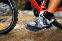 foot of mountainbiker pedaling