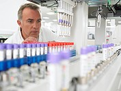 Scientist examining test tubes in laboratory (thumbnail)