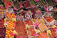 Variety of fresh fruit and price cards at market