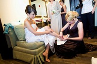 Bride putting on shoes, weddin day, bridal preperatoins