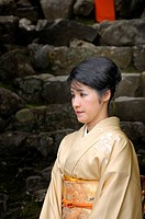 Japanese woman in a kimono visiting the Kamigamo shrine in Kyoto, Japan, Asia