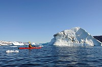 Kayaker in Stoklund Fjord, East Greenland, Greenland