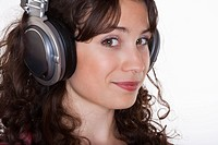 young woman listening to music with headphones on her ears
