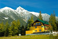 Hotel in front of mountain peak Reitherspitze, autumn, Seefeld, Karwendel, the Alps, Austria, Europe
