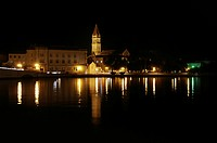 Night shot, reflection of lights in water, church tower, steeple, Cathedral of St. Laurence, Trogir, Croatia, Europe