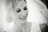 bride smiling with veil on