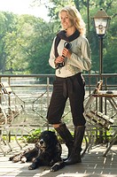 Model with a dog in a beer garden, at a lake