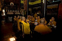 Monks sitting at a dining table, Giac Lam Pagoda, Ho Chi Minh City, Vietnam