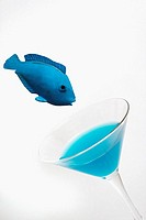 A photo illustrating the concept or phrase of 'Drinks like a fish' which depending on the circumstance can be interpreted as funny or a tragic addicti...