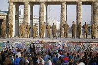 Fall of the Berlin Wall: Soldiers saving the wall at the Brandenburg Gate, Berlin, Germany