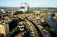 Hot air balloon in flight over a city