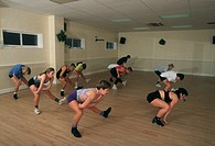 Women participating in a boxercise work out