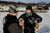 Scuba diver before diving in the fjord for king crabs, Kirkenes, Finnmark, Lapland, Norway, Scandinavia, Europe