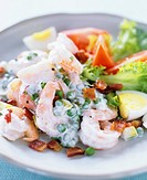 Shrimp and pea salad with fried bacon
