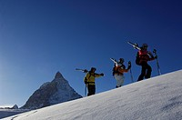 Back country skiers, freeriders, hiking over the Sandiger Boden ski area in front of the Matterhorn Mountain, Zermatt, Valais or Wallis, Switzerland, ...