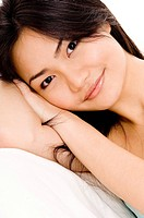 A beautiful young asian woman resting and smiling