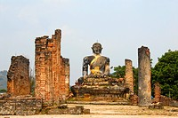 Ancient buddha statue and columns of the buddhist temple of Wat Phia Wat destroyed in the Vietnam war, Muang Khoun, Xieng Khuang, Laos, South East Asi...