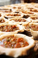 Unbaked beef pot pies in pie dishes