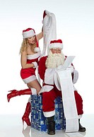 Nikolaus and Santa Claus with long wish list