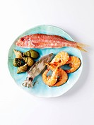 Assorted seafood on blue plate